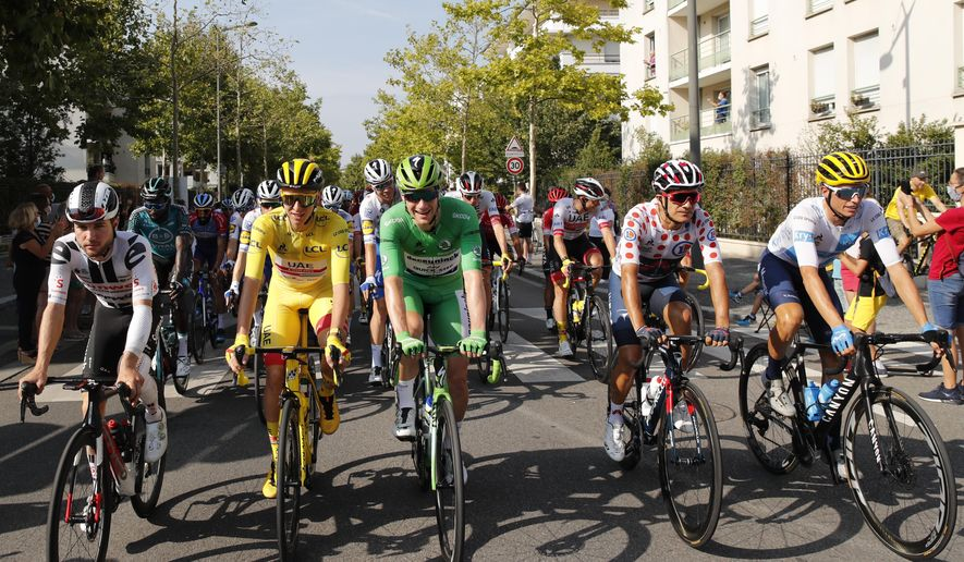 Tadej Pogacar of Slovenia, wearing the overall leader's yellow jersey, Richard Carapaz of Ecuador, runner-up to Pogacar as best climber wearing the dotted jersey, Spain's Enric Mas, runner-up to Pogacar for the best young rider wearing the white jersey, and Sam Bennett of Ireland, wearing the best sprinter's green jersey, and Most combative rider of the Tour de France, Marc Hirschi of Switzerland, left, take the start of the twenty-first and last stage of the Tour de France cycling race over 122 kilometers (75.8 miles), from Mantes-la-Jolie to Paris, France, Sunday, Sept. 20, 2020. (AP Photo/=332028000404=)