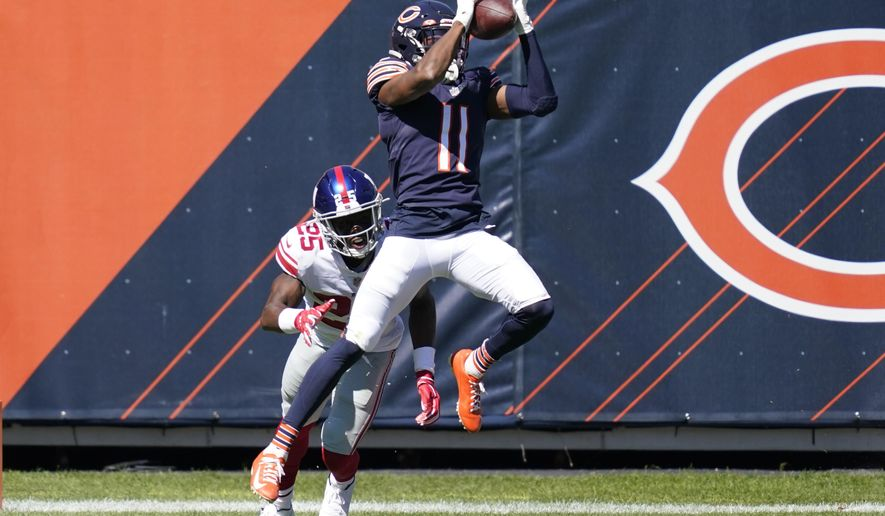 Chicago Bears wide receiver Darnell Mooney (11) catches a 15-yard touchdown pass as New York Giants cornerback Corey Ballentine (25) defends during the first half of an NFL football game in Chicago, Sunday, Sept. 20, 2020. (AP Photo/Charles Rex Arbogast)
