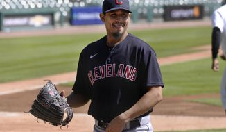 Cleveland Indians starting pitcher Carlos Carrasco walks to the dugout after striking out Detroit Tigers' Miguel Cabrera in the first inning of a baseball game, Sunday, Sept. 20, 2020, in Detroit. (AP Photo/Jose Juarez)