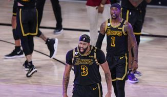 Los Angeles Lakers' Anthony Davis (3) celebrates after an NBA conference final playoff basketball game against the Denver Nuggets Sunday, Sept. 20, 2020, in Lake Buena Vista, Fla. The Lakers won 105-103. (AP Photo/Mark J. Terrill)  **FILE**