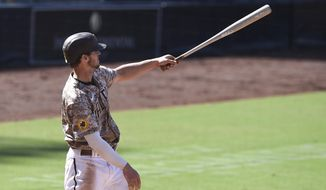 San Diego Padres' Wil Myers watches his three-run home run during the sixth inning of a baseball game against the Seattle Mariners, Sunday, Sept. 20, 2020, in San Diego. (AP Photo/Denis Poroy)