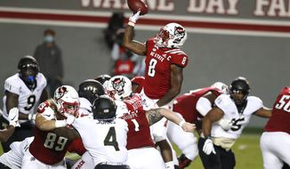 North Carolina State running back Ricky Person Jr. (8) throws a 2-yard touchdown pass during the second half of the team's 45-42 victory over Wake Forest in an NCAA college football game in Raleigh, N.C, Saturday, Sept. 19, 2020. (Ethan Hyman/The News & Observer via AP)