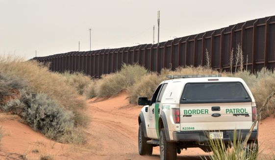 An analysis of Democratic presidential nominee Joseph R. Biden's immigration plans finds that he would halt border wall construction. (Associated Press)