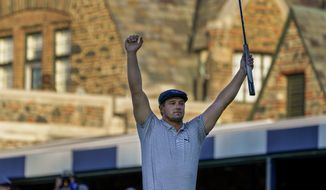Bryson DeChambeau, of the United States, reacts after sinking a putt for par on the 18th hole to win the US Open Golf Championship, Sunday, Sept. 20, 2020, in Mamaroneck, N.Y. (AP Photo/Charles Krupa)  **FILE**