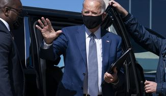 Democratic presidential candidate former Vice President Joe Biden waves as he arrives to board a plane at New Castle Airport, in New Castle, Del., Monday, Sept. 21, 2020, en route to Manitowoc, Wis. (AP Photo/Carolyn Kaster)