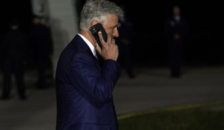 National Security Adviser Robert O'Brien talks on the phone as President Donald Trump speaks during a campaign rally at Eugene F. Kranz Toledo Express Airport, Monday, Sept. 21, 2020, in Swanton, Ohio. (AP Photo/Alex Brandon)