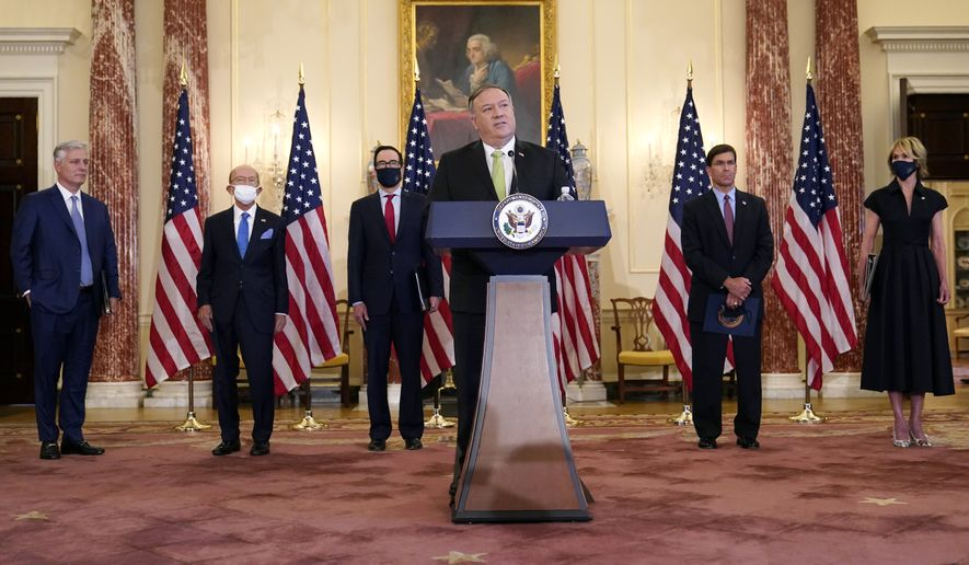 Secretary of State Mike Pompeo speaks during a news conference to announce the Trump administration's restoration of sanctions on Iran, Monday, Sept. 21, 2020, at the U.S. State Department in Washington. Standing behind Pompeo are from left, National Security Adviser Robert O'Brien, Commerce Secretary Wilbur Ross, Treasury Secretary Steve Mnuchin, Defense Secretary Mark Esper and U.S. Ambassador to the United Nations Kelly Craft. (AP Photo/Patrick Semansky)