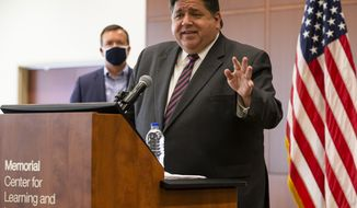 Illinois Governor JB Pritzker talks about the amount of testing going on for professional sports and players staying in a bubble compared to high school athletes when asked why high school football was being delayed during a press conference to speak about the state surpassing 5 million COVID-19 tests since the beginning of the pandemic at the Memorial Center for Learning and Innovation, Monday, Sept. 21, 2020, in Springfield, Ill. (Justin L. Fowler/The State Journal-Register via AP)