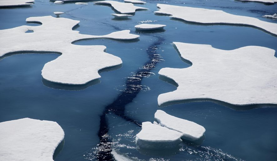 Sea ice breaks apart as the Finnish icebreaker MSV Nordica traverses the Northwest Passage through the Victoria Strait in the Canadian Arctic Archipelago in a Friday, July 21, 2017, file photo.  The National Snow and Ice Data Center's figures Monday, Sept. 21, 2020, show that sea ice last week was only 1.4 million square miles when it reached its annual low mark for the summer. In the 1980s it was always at least 1 million square miles more. (AP Photo/David Goldman, File)
