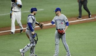 Toronto Blue Jays relief pitcher Ken Giles, right, celebrates with catcher Danny Jansen after closing out the Tampa Bay Rays during the ninth inning of a baseball game Friday, July 24, 2020, in St. Petersburg, Fla. (AP Photo/Chris O'Meara)