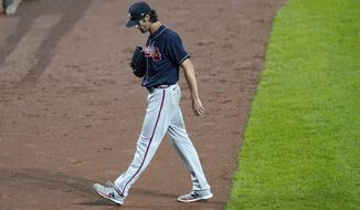 Atlanta Braves starting pitcher Cole Hamels heads to the dugout after being pulled from the mound during the fourth inning of a baseball game against the Baltimore Orioles, Wednesday, Sept. 16, 2020, in Baltimore. (AP Photo/Julio Cortez)
