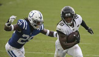 Jacksonville Jaguars wide receiver Laviska Shenault Jr. (10) runs past Indianapolis Colts free safety Malik Hooker, left, during the first half of an NFL football game, Sunday, Sept. 13, 2020, in Jacksonville, Fla. (AP Photo/Stephen B. Morton)