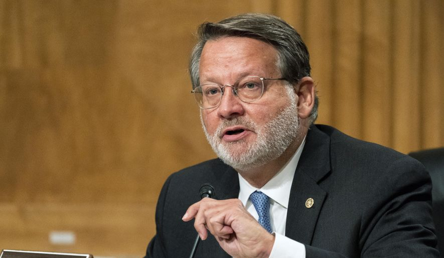 In this Sept. 6, 2020, file photo, Senate Homeland Security and Governmental Affairs Committee ranking member Sen. Gary Peters, D-Mich., speaks on Capitol Hill, in Washington. (AP Photo/Manuel Balce Ceneta File)