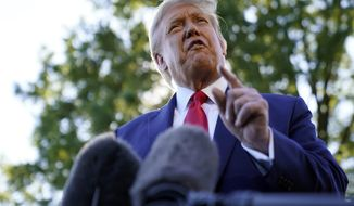President Donald Trump speaks to reporters on the South Lawn of the White House, Monday, Sept. 21, 2020, before leaving for a short trip to Andrews Air Force Base, Md., and then onto Ohio for rallies. (AP Photo/Andrew Harnik)