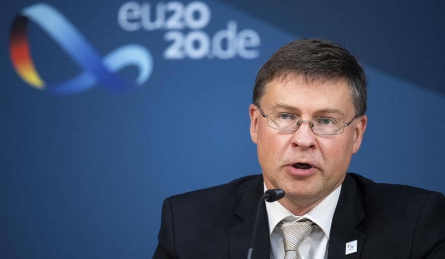 Valdis Dombrovskis, Vice-President of the EU Commission, speaks at a press conference in Berlin, Germany, following the informal talks of the EU Trade Ministers on Monday, Sept. 21, 2020.  (Bernd von Jutrczenka/Pool via AP)