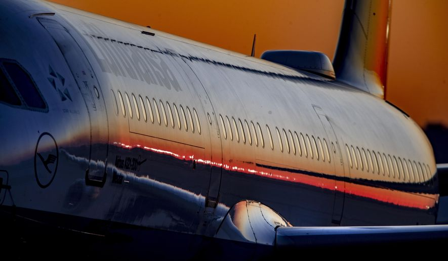 A Lufthansa aircraft rolls to the parking position at the airport in Frankfurt, Germany, Wednesday, Sept. 9, 2020. (AP Photo/Michael Probst)