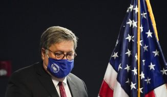 U.S. Attorney General William Barr arrives to speak with federal officials for a panel discussion on combatting human trafficking at the U.S. Attorney's Office on Monday, Sept. 21, 2020, in Atlanta. (AP Photo/Brynn Anderson)