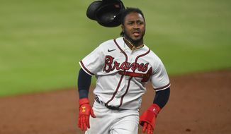 Atlanta Braves' Ozzie Albies rounds second base on a line drive double to right field by Austin Riley during the first inning of a baseball game against the Miami Marlins, Monday, Sept. 21, 2020, in Atlanta. (AP Photo/John Amis)