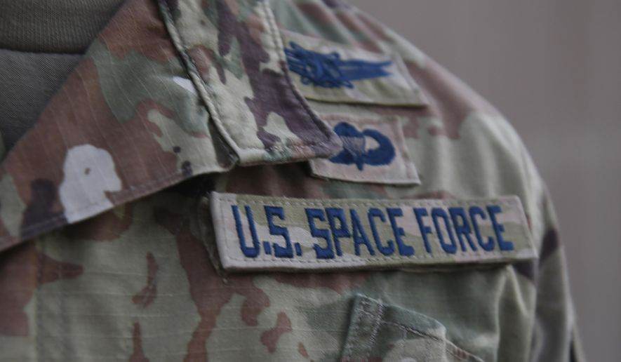In this photo released by the U.S. Air Force, Capt. Ryan Vickers stands for a photo to display his new service tapes after taking his oath of office to transfer from the U.S. Air Force to the U.S. Space Force at Al-Udeid Air Base, Qatar, Tuesday, Sept. 1, 2020. Space Force, the first new U.S. military service since the creation of the Air Force in 1947, now has some 20 members stationed at Qatar's Al-Udeid Air Base in its first foreign deployment. (Staff Sgt. Kayla White/U.S. Air Force via AP)