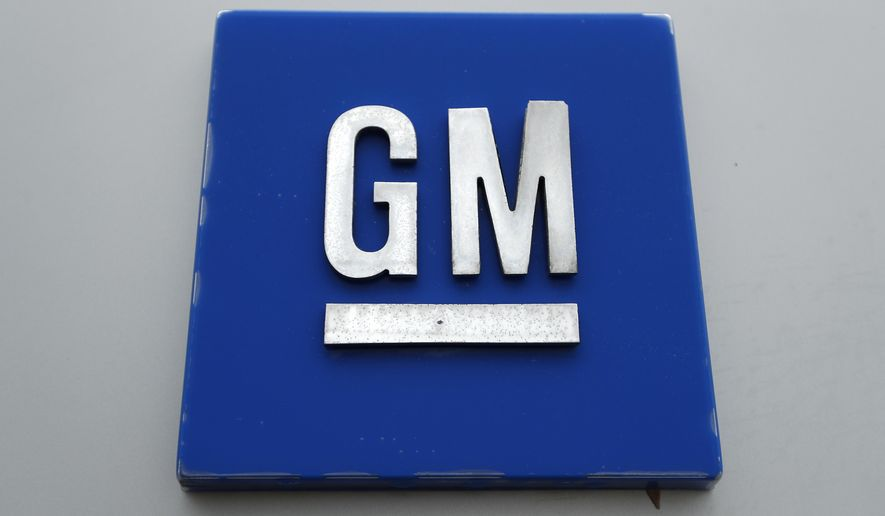 This Jan. 27, 2020, file photo shows a General Motors logo at the General Motors Detroit-Hamtramck Assembly plant in Hamtramck, Mich. Shares in electric- and hydrogen-powered truck startup Nikola plunged on Monday, Sept. 21, 2020, after the company's founder Trevor Milton resigned amid allegations of fraud — just two weeks after signing a $2 billion partnership with General Motors. (AP Photo/Paul Sancya, File)