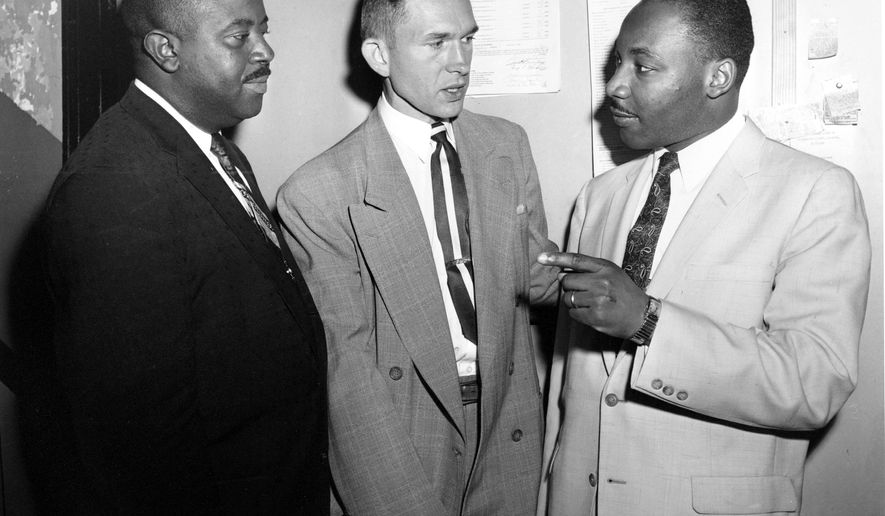 FILE - In this May 28, 1957, file photo, Rev. Ralph D. Abernathy, left, Rev. Robert S. Graetz, center, pastor of Trinity Lutheran Church, and Rev. Dr. Martin Luther King Jr. talk outside the witness room during a bombing trial in Montgomery, Ala. Abernathy's church and home were bombed as well as the home of Graetz, who has an all-Black congregation. A wave of bombings took place after full integration on buses that resulted from the 13-month Montgomery Bus Boycott. Graetz, the only white minister to support the Montgomery bus boycott, died Sunday, Sept. 20, 2020. He was 92. (AP Photo/File)