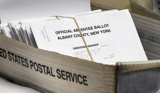 In this June 30, 2020, photo, a box of absentee ballots wait to be counted at the Albany County Board of Elections in Albany, N.Y. A New York federal judge ordered the U.S. Postal Service to live up to its responsibilities to timely process election mail. The Monday, Sept. 21 written decision by Judge Victor Marrero came after several individuals including candidates for public office sued. (AP Photo/Hans Pennink) **FILE**