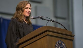 In this May 19, 2018, photo, Amy Coney Barrett, United States Court of Appeals for the Seventh Circuit judge, speaks during the University of Notre Dame's Law School commencement ceremony at the university, in South Bend, Ind. Barrett, a front-runner to fill the Supreme Court seat vacated by the death of Justice Ruth Bader Ginsburg, has established herself as a reliable conservative on hot-button legal issues from abortion to gun control. (Robert Franklin/South Bend Tribune via AP) **FILE**