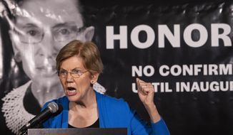 Sen. Elizabeth Warren, D-Mass., speaks at the Supreme Court to honor the late Justice Ruth Bader Ginsburg, Saturday, Sept. 19, 2020 in Washington.  (AP Photo/Cliff Owen)