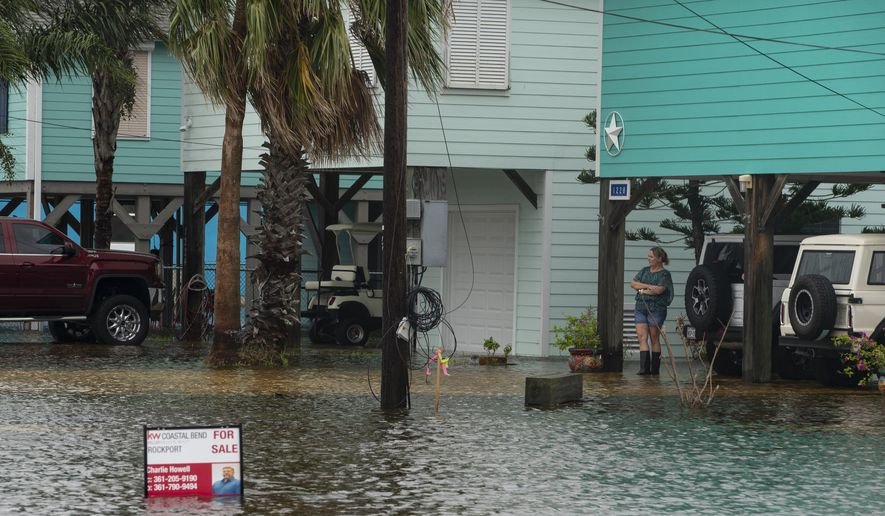 A flooded streets in Rockport, Texas, as Tropical Storm Beta approaches on Monday, Sept. 21, 2020.  (Courtney Sacco/Corpus Christi Caller-Times via AP)