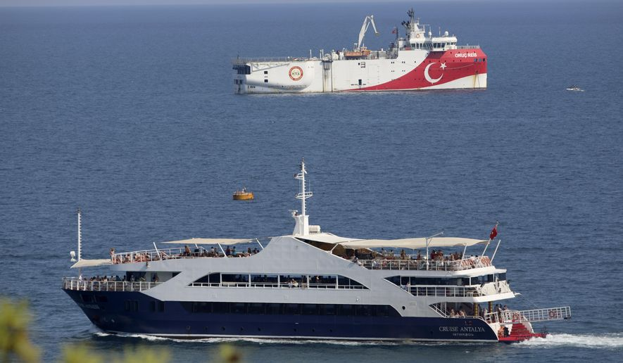 Turkey's research vessel, Oruc Reis, rear, anchored off the coast of Antalya on the Mediterranean, Turkey, Sunday, Sept. 13, 2020. Greece's Prime Minister Kyriakos Mitsotakis welcomed the return of a Turkish survey vessel to port Sunday from a disputed area of the eastern Mediterranean that has been at the heart of a summer stand-off between Greece and Turkey over energy rights. (AP Photo/Burhan Ozbilici)