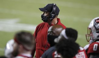 North Carolina State coach Dave Doeren watches from the sideline during the second half of the team's NCAA college football game against Wake Forest in Raleigh, N.C, Saturday, Sept. 19, 2020. (Ethan Hyman/The News & Observer via AP)