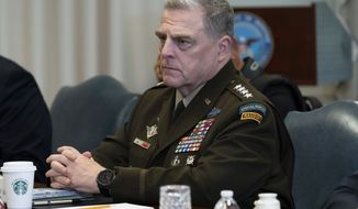 In this file photo, Joint Chiefs Chairman Gen. Mark Milley listens before a meeting with Secretary of Defense Mark Esper and Israeli Defense Minister Benny Gantz, at the Pentagon, Tuesday, Sept. 22, 2020, in Washington. (AP Photo/Alex Brandon)