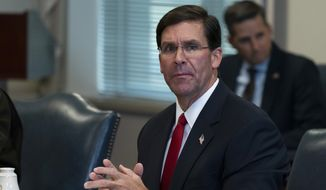 In this file photo, Secretary of Defense Mark Esper speaks before a meeting with Israeli Defense Minister Benny Gantz, at the Pentagon, Tuesday, Sept. 22, 2020, in Washington. (AP Photo/Alex Brandon)  ** FILE **