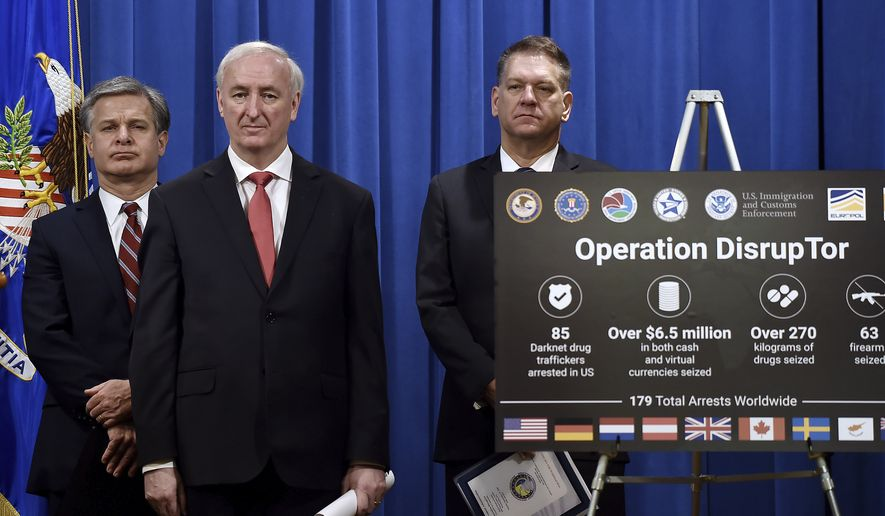 """From left, FBI Director Christopher Wray, Deputy Attorney General Jeffrey Rosen and DEA Acting Administrator Timothy Shea, announce a worldwide crackdown on opioid trafficking on the darknet, during a press conference at the Department of Justice, Tuesday, Sept. 22, 2020 in Washington.  Law enforcement officials have arrested 179 people and seized more than $6.5 million. The operation announced Tuesday mainly occurred in the U.S. and in Europe. Rosen said the takedown showed """"there will be no safe haven for drug dealing in cyberspace."""" (Olivier Douliery/Pool via AP)"""