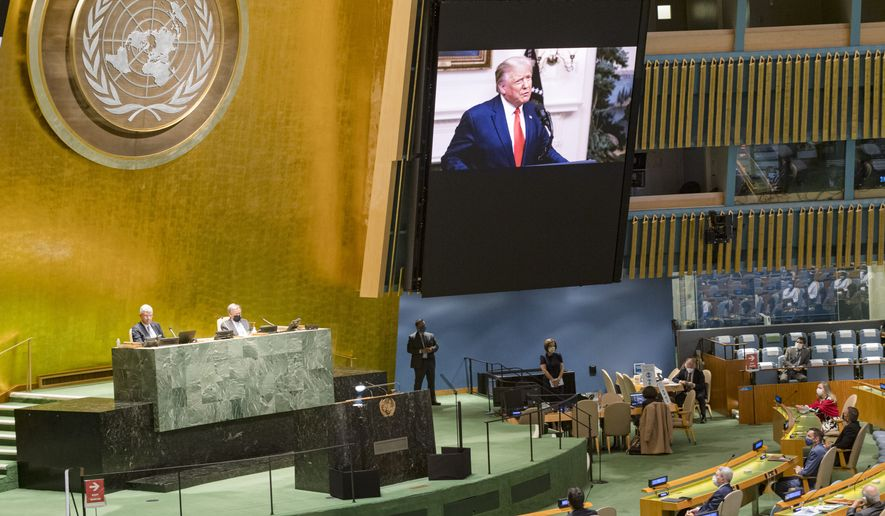 In this photo provided by the United Nations, U.S. President Donald Trump, is on video screens as his pre-recorded message is played during the 75th session of the United Nations General Assembly, Tuesday, Sept. 22, 2020, at U.N. Headquarters in New York. The U.N.'s first virtual meeting of world leaders started Tuesday with pre-recorded speeches from some of the planet's biggest powers, kept at home by the coronavirus pandemic that will likely be a dominant theme at their video gathering this year. (U.N. Photo/Rick Bajornas via AP)