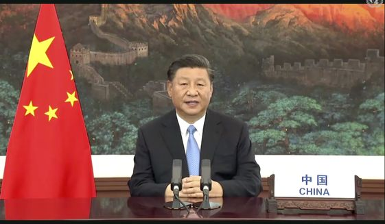 In this image made from UNTV video, Chinese President Xi Jinping speaks in a pre-recorded message which was played during the 75th session of the United Nations General Assembly, Tuesday, Sept. 22, 2020, at U.N. headquarters in New York. The U.N.'s first virtual meeting of world leaders started Tuesday with pre-recorded speeches from some of the planet's biggest powers, kept at home by the coronavirus pandemic that will likely be a dominant theme at their video gathering this year. (UNTV via AP)