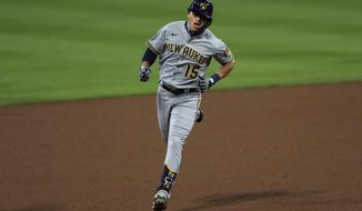 Milwaukee Brewers' Tyrone Taylor runs the bases after hitting a solo home run in the fifth inning of a baseball game against the Cincinnati Reds in Cincinnati, Tuesday, Sept. 22, 2020. (AP Photo/Aaron Doster)