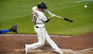 Pittsburgh Pirates' Jacob Stallings hits a walk-off solo home run off Chicago Cubs relief pitcher Andrew Chafin during the bottom of the ninth inning of a baseball game in Pittsburgh, Tuesday, Sept. 22, 2020. The Pirates won 3-2. (AP Photo/Gene J. Puskar)