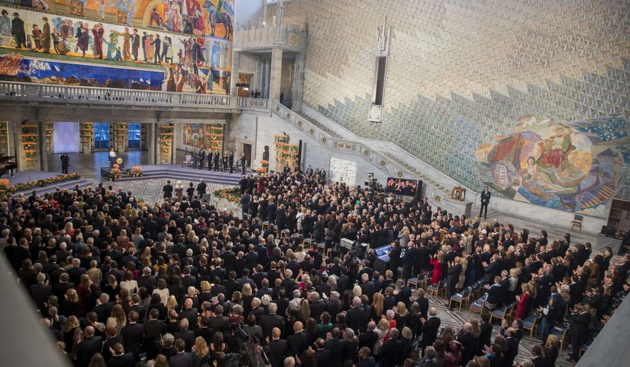 FILE - In this Monday Dec. 10, 2018 file photo, guests attend the Nobel Peace Prize Ceremony in Oslo Town Hall, Oslo. Dr. Denis Mukwege from Congo and Nadia Murad from Iraq will jointly receive the Nobel Peace Prize for their efforts to end the use of sexual violence as a weapon of war and armed conflict. The award ceremony for the 2020 Nobel Peace Prize, traditionally held at the Oslo city hall on Dec. 10, will instead be held in scaled-down form at the city's university because of the coronavirus outbreak. (Berit Roald/NTB Scanpix via AP, File)