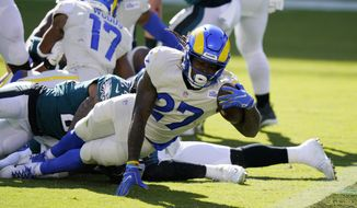 Los Angeles Rams' Darrell Henderson scores a touchdown during the second half of an NFL football game against the Philadelphia Eagles, Sunday, Sept. 20, 2020, in Philadelphia. (AP Photo/Chris Szagola)