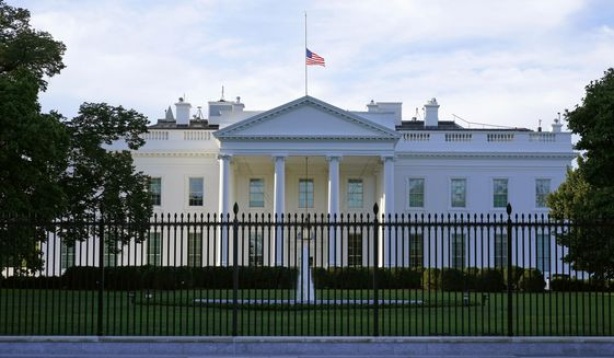 FILE - In this Saturday, Sept. 19, 2020, file photo, an American flag flies at half-staff over the White House in Washington. A woman suspected of sending an envelope containing the poison ricin, which was addressed to White House, has been arrested at the New York-Canada border. (AP Photo/Patrick Semansky, File)