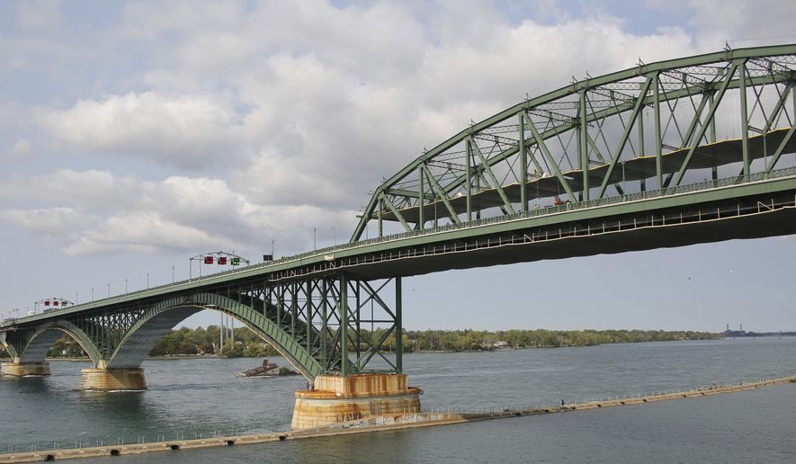 This photo shows a general view of the Peace Bridge, Tuesday, Sept. 22, 2020, in Buffalo N.Y.  Pascale Ferrier, a Canadian woman accused of mailing a package containing the poison ricin to the White House, was taken into custody Sunday, Sept. 20 by U.S. Customs and Border Protection officers at the Peace Bridge border crossing near Buffalo and is expected to face federal charges Tuesday in Buffalo, New York. (AP Photo/Jeffrey T. Barnes)