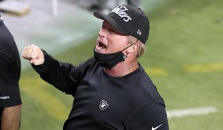 Las Vegas Raiders head coach Jon Gruden celebrates after defeating the New Orleans Saints in an NFL football game, Monday, Sept. 21, 2020, in Las Vegas. (AP Photo/Isaac Brekken)  **FILE**