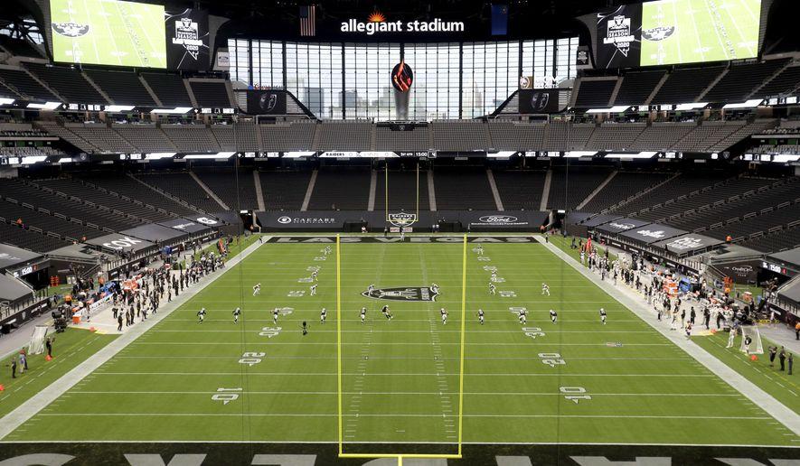 The Las Vegas Raiders kick off to the New Orleans Saints to start an NFL football game, Monday, Sept. 21, 2020, in Las Vegas. (AP Photo/Isaac Brekken)