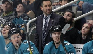 FILE - In this Monday, Jan. 7, 2020, file photo, San Jose Sharks interim coach Bob Boughner watches during an NHL hockey game against the Anaheim Ducks, in San Jose, Calif. The San Jose Sharks have retained Bob Boughner as their coach, removing the interim tag to make him the ninth full-time head coach in franchise history. The Sharks finalized their coaching staffs at the NHL and AHL levels Tuesday, Sept. 22, 2020. (AP Photo/Jeff Chiu, File)