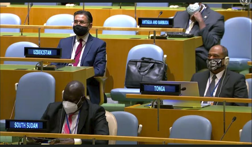 """In this image made from UNTV, representatives of different countries listen to speakers during the 75th session of the United Nations General Assembly, Tuesday, Sept. 22, 2020, at U.N. headquarters in New York. This year's annual gathering of world leaders at U.N. headquarters is almost entirely """"virtual."""" Leaders have been asked to pre-record their speeches, which are being shown in the General Assembly chamber, where each of the 193 U.N. member nations are allowed to have one diplomat present. (UNTV via AP )"""