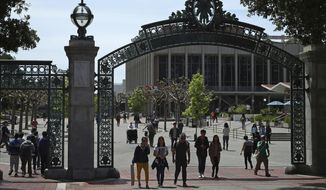 In this May 10, 2018, file photo, students walk past Sather Gate on the University of California at Berkeley campus in Berkeley, Calif.  (AP Photo/Ben Margot, File)  **FILE**