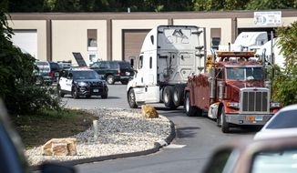 The scene of a shooting at 105 Edwin Road Tuesday, Sept. 22, 2020, in South Windsor, Conn.  A shooter opened fire and wounded two people at the Connecticut business on Tuesday before being caught trying to flee in Massachusetts. police said. The shooting happened in an industrial section of South Windsor at Independent Truck & Tractor Repair. No details of a motive have been released.  (Kassi Jackson/Hartford Courant via AP)