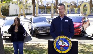 This screen shot from pool video shows California Gov. Gavin Newsom announcing Wednesday, Sept. 23, 2020 that the state will halt sales of new gasoline-powered passenger cars and trucks by 2035, in Sacramento, Calif. On Wednesday he ordered state regulators to come up with requirements to meet that goal. California would be the first state with such a rule, though Germany and France are among 15 other countries that have a similar requirement. (Pool via AP)