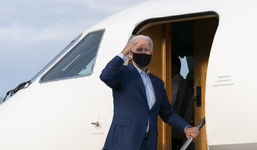 Democratic presidential candidate former Vice President Joe Biden salutes as he boards a plane at Charlotte Douglas International Airport in Charlotte, N.C., Wednesday, Sept. 23, 2020, en route to Wilmington, De. (AP Photo/Carolyn Kaster)